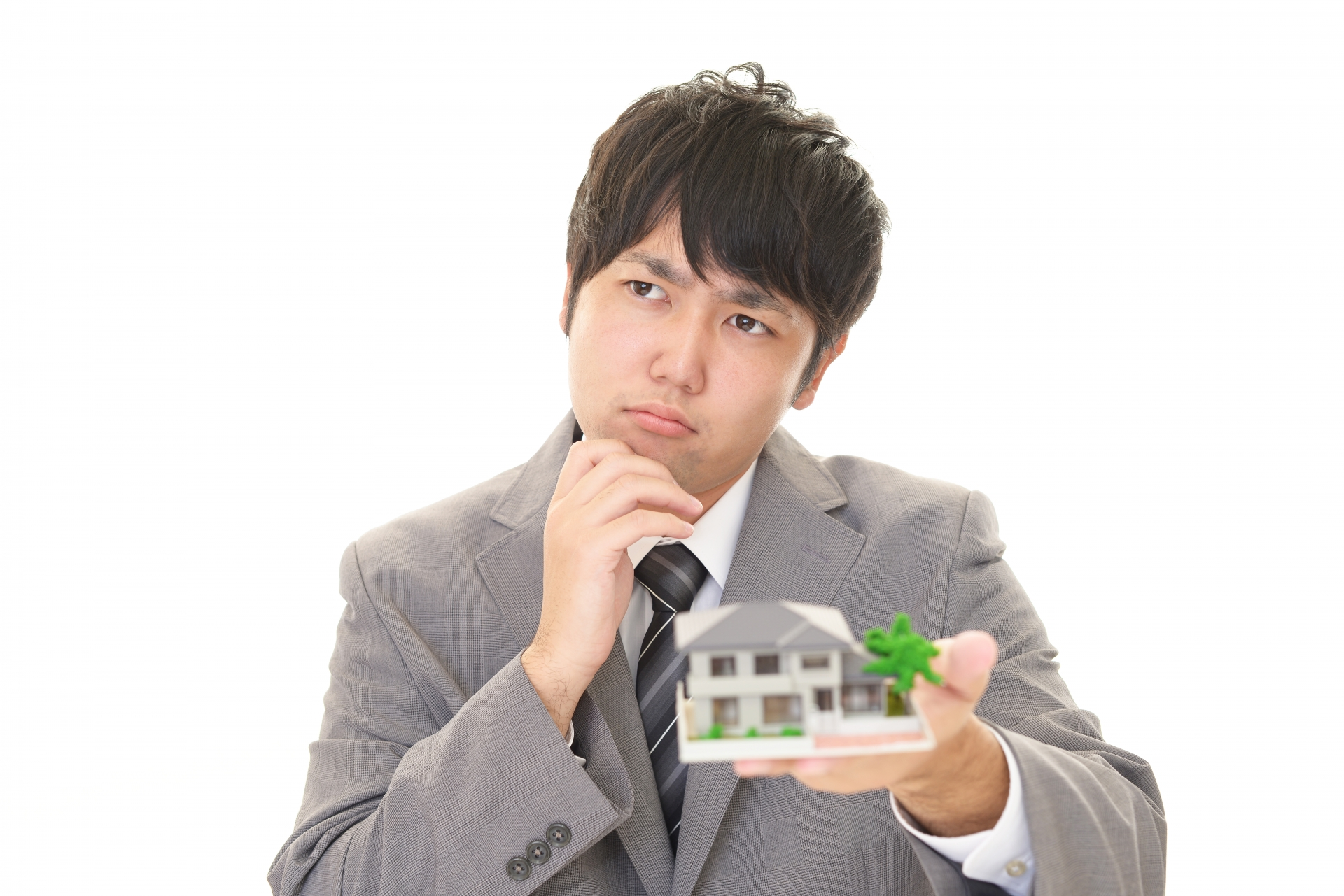 宅建の学習に悩んでいる男性